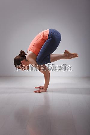 fit yogini woman practices yoga asana