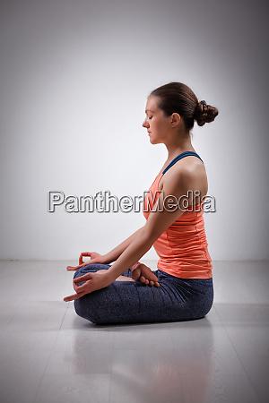 woman meditate in yoga asana padmasana