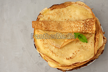 stack of fried round pancakes on
