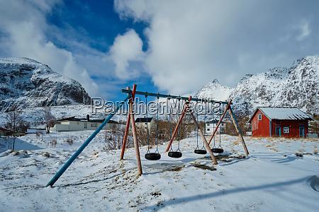 children playground in winter a village