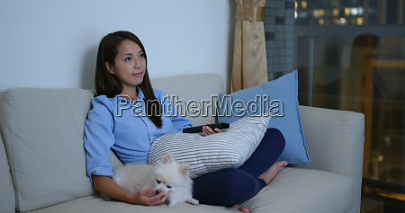 woman watch tv at home with