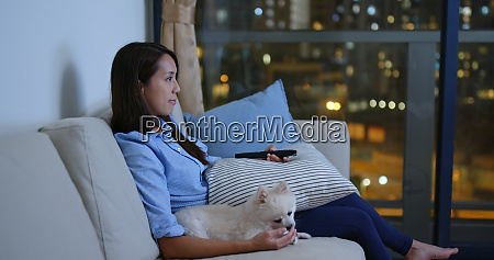 woman watch tv with her dog