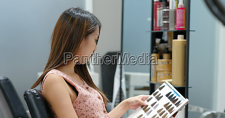 woman look at color book of