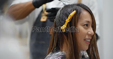 woman have hair dye at beauty