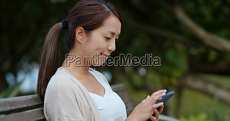 woman touch on mobile phone in
