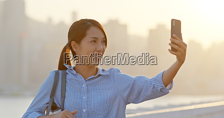 woman use of mobile phone for