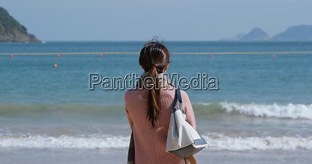 woman looks at the sea at