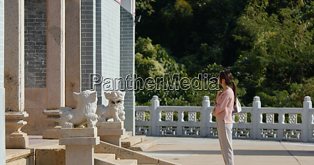 woman visit chinese temple in hong