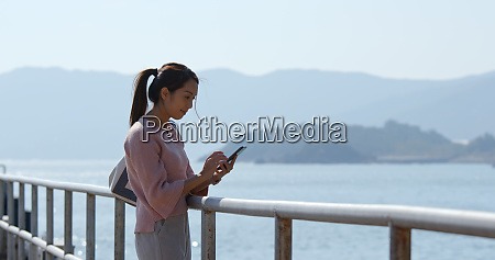 woman use of mobile phone at