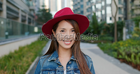 woman smile to camera at outdoor