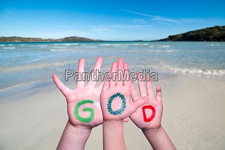 children hands building word god ocean