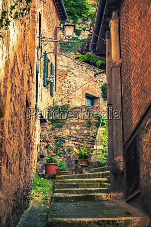 narrow street in montepulciano tuscany italy