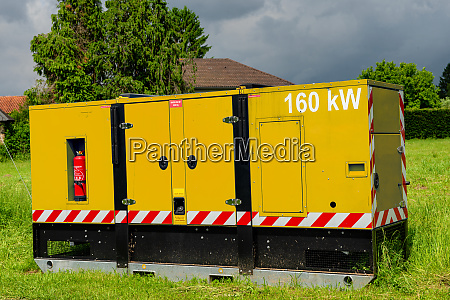 yellow power generator in the countryside