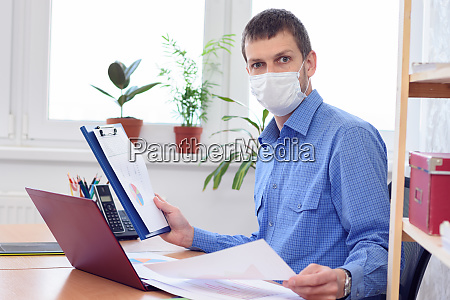 office worker in medical mask examines