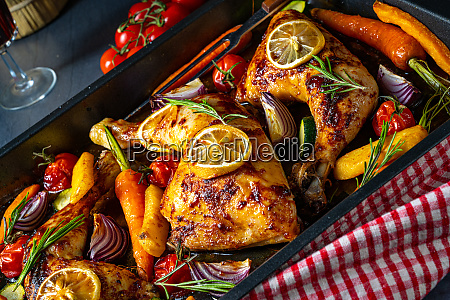 grilled chicken legs with various vegetables