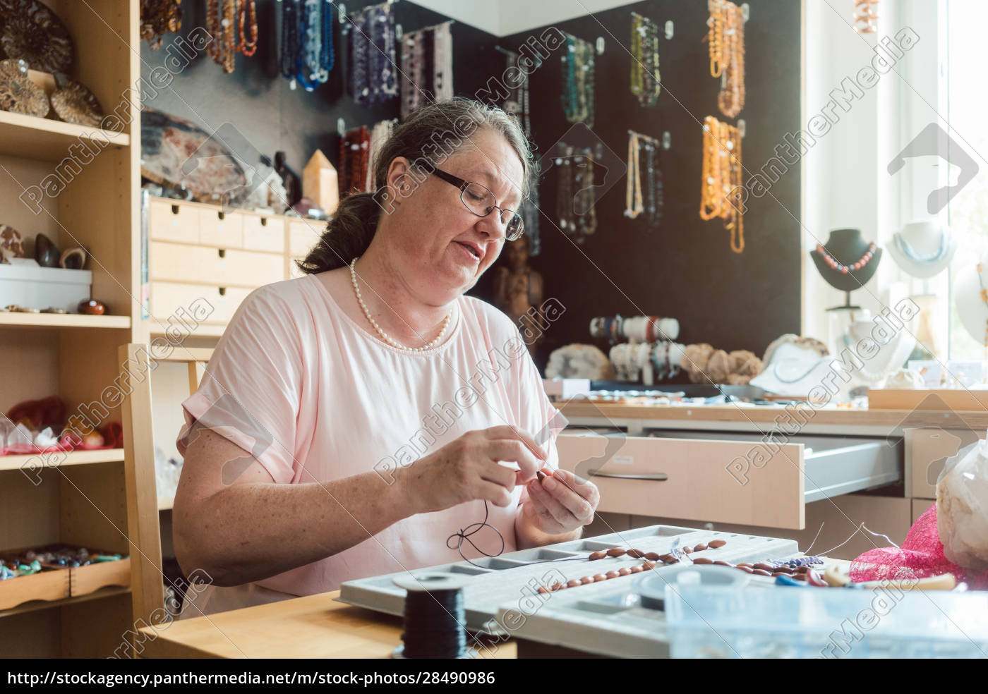 woman, working, on, a, gemstone, necklace - 28490986