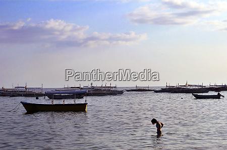 boots at the coast of panglao