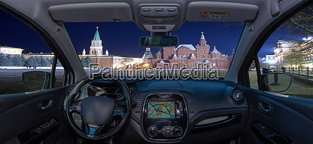 car windshield view of red square