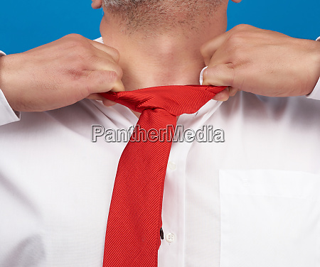 man in a white office shirt