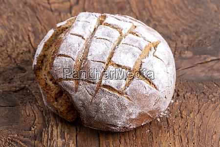 fresh rye bread on dark wood