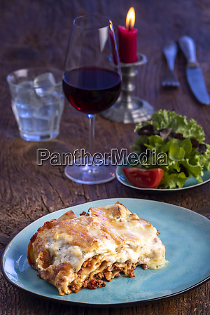 fresh lasagna on a blue plate