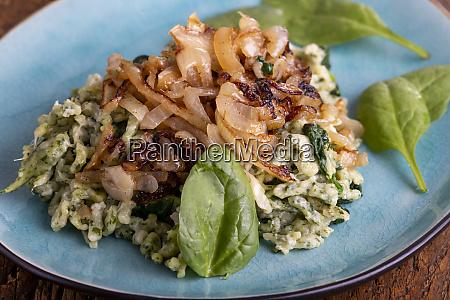 bavarian spinach spaetzle on wood