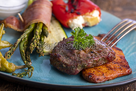 grilled meat and green asparagus on