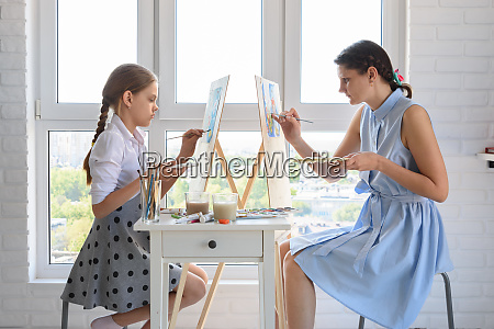 girl and tutor conduct a joint