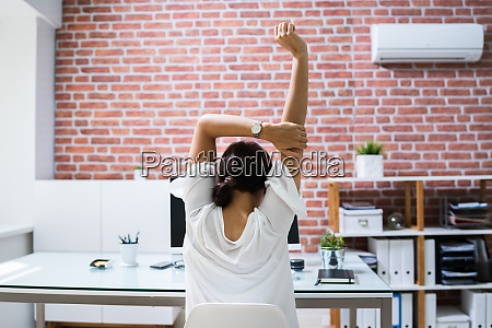 woman employee doing stretch exercise