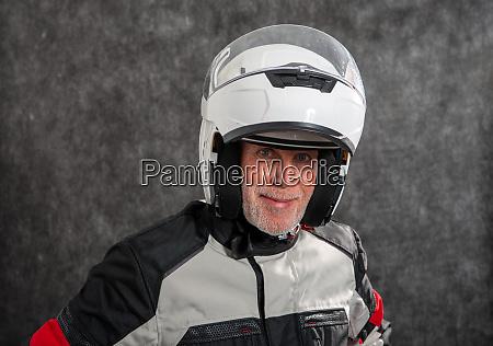 portrait of senior biker with helmet