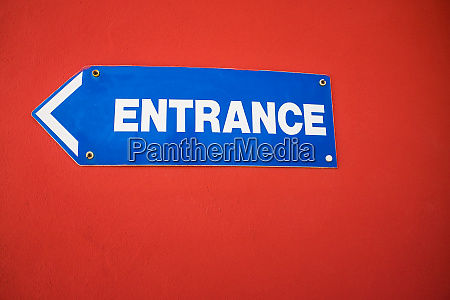 entrance sign mounted on a bright