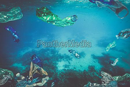 plastic waste bottle bags floating underwater