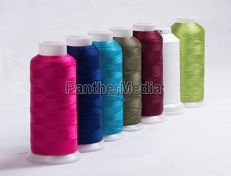 yarn rolls in various colors against