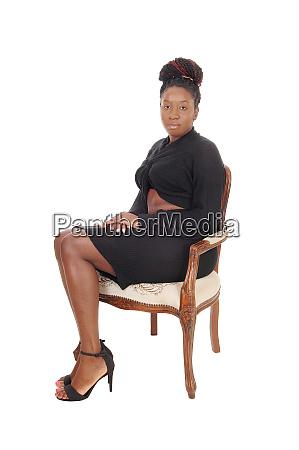 beautiful woman sitting in a gray