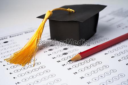 graduation gap hat and pencil on