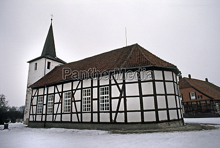 half timpered church in the snow