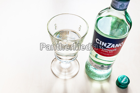 cap and bottle of cinzano extra