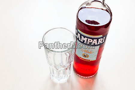 empty glass and bottle of campari