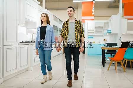 young love couple in furniture store