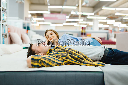 love couple lying in bed furniture