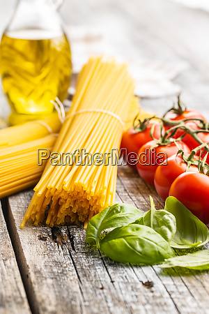 raw spaghetti pasta cherry tomatoes basil