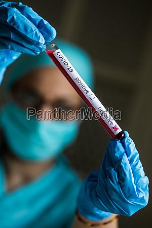 doctor hands holding a coronavirus covid