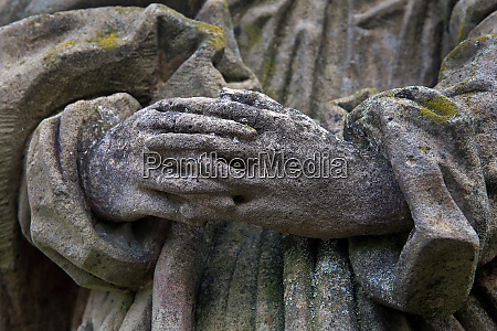 hands of a stone sculpture