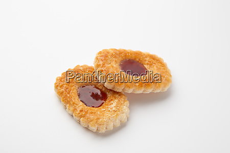 cookies with jam on a white