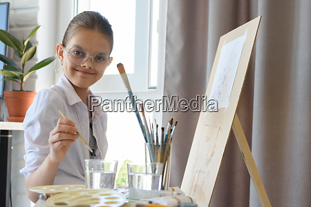 happy girl with glasses with brush