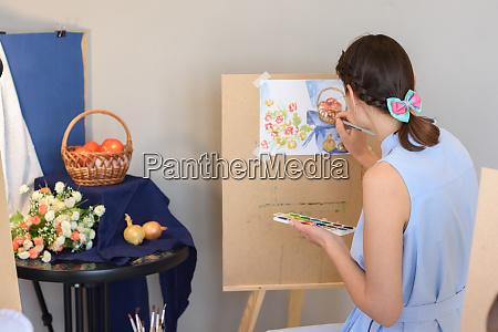 artist draws still life watercolor paints