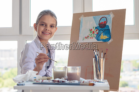 smiling girl sits at work in