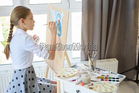 girl gently draws still life sitting