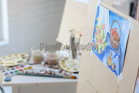 artists workplace with an easel on