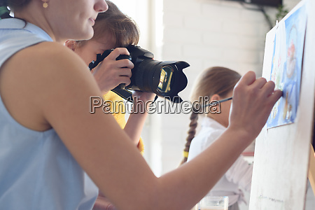 girl takes pictures of how the